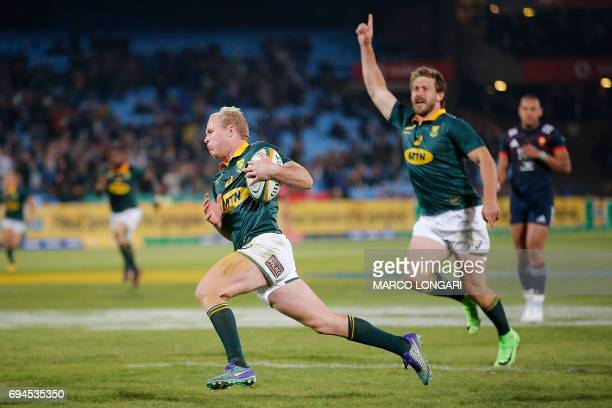South Africa's scrum half Ross Cronje runs to score a try during the first rugby union Test match between South Africa and France at the Loftus...