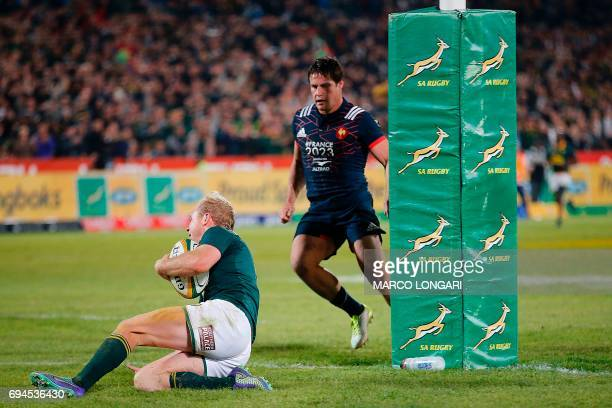 South Africa's scrum half Ross Cronje scores a try during the first rugby union Test match between South Africa and France at the Loftus Versfeld...