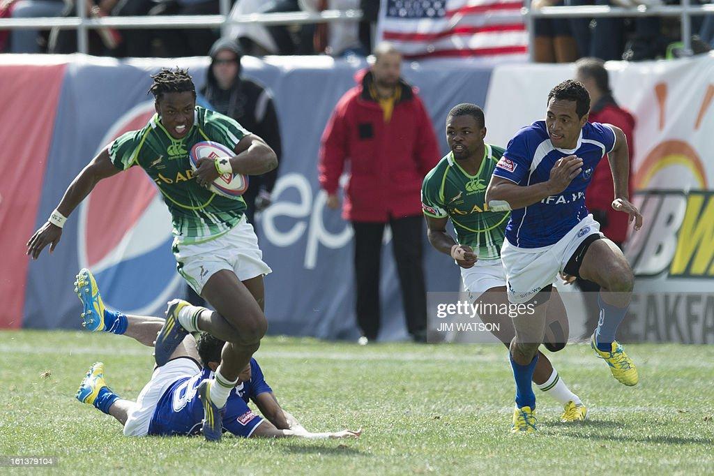 South Africa's Seabelo Senata (L) vies with Samoa during Day 3 of the USA Sevens Las Vegas HSBC Sevens World Series Round 5 at Sam Boyd Stadium in Las Vegas on February 10, 2013. AFP PHOTO/Jim WATSON