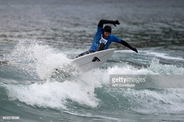 South Africa's Shannon Ainsle rides a wave during the Lofoten Masters 2017 the northernmost surf contest in the world on September 23 2017 in...