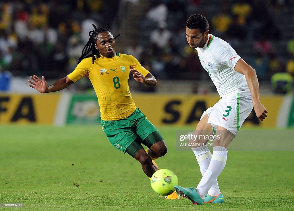 South Africa's Siphiwe Tshabalala (L) vies with Algeria's Liassine Cadamuro during a friendly football match between South Africa's Bafana Bafana and Algeria in Soweto on January 12 , 2013, ahead of the 2013 African Cup of Nations that will take place in South Africa from January 19 to February 10.