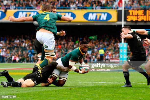 South Africa's Siya Kolisi is tacked during the Rugby test match between South Africa and New Zealand at Newlands Rugby stadium on October 7 2017 in...