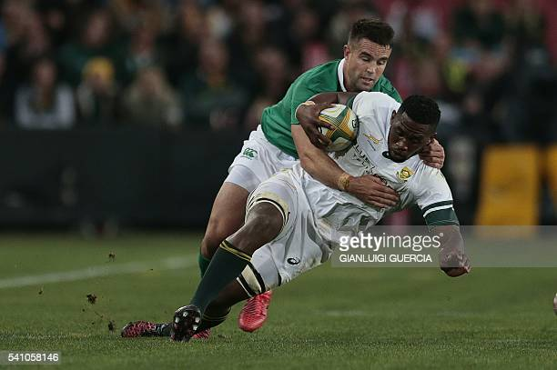 South Africa's Siya Kolisi is tackled by Ireland's Conor Murray during the second Rugby Test match between South Africa and Ireland at Ellis Park on...