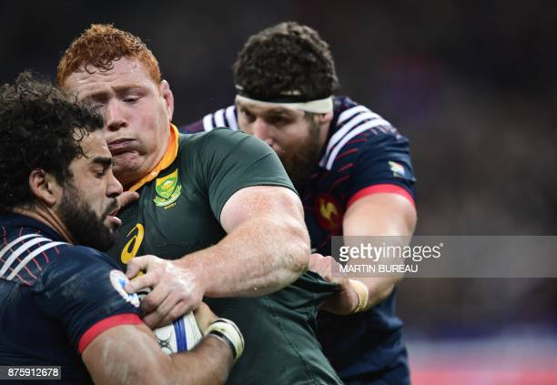South Africa's Steven Kitshoff tackles France's wing Yoann Huget during the friendly rugby union international Test match between France and South...