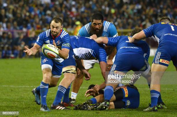 South Africa's Stormers' scrumhalf Dewaldt Duvenage passes the ball during the Super Rugby match New Zealand's Blues against South Africa's Stormers...