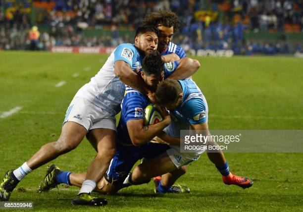 South Africa's Stormers' Shaun Treeby runs with the ball during the Super Rugby match New Zealand's Blues against South Africa's Stormers on May 19...