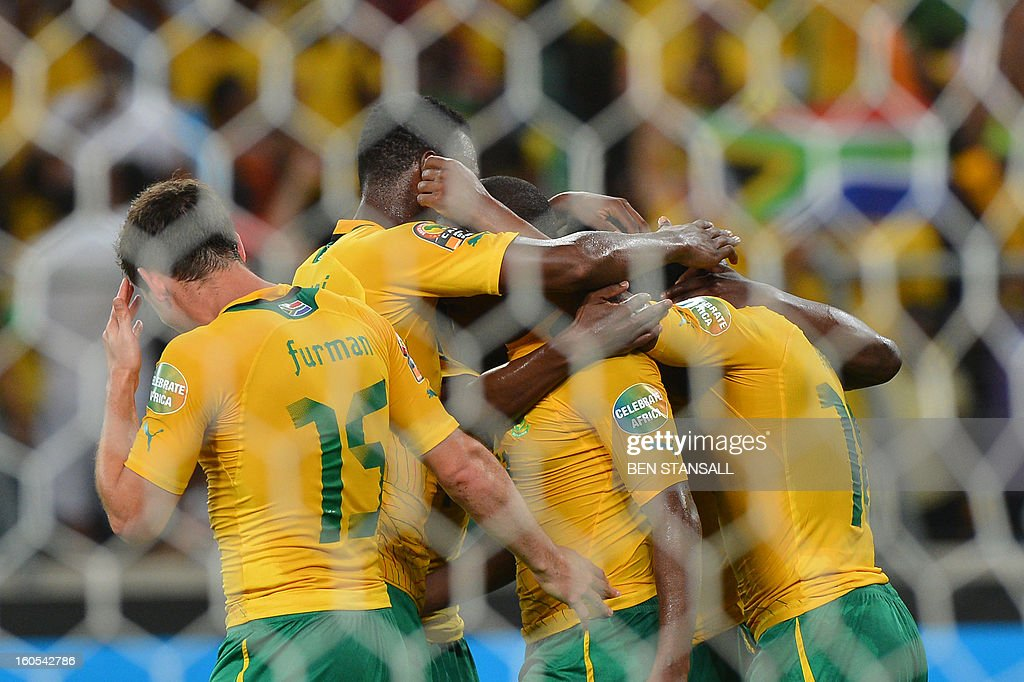 South Africa's striker Tokelo Rantie (C) is congratulated by teammates after scoring a goal during the African Cup of Nation 2013 quarter final football match South-Africa vs Mali, on February 2, 2013 in Durban.