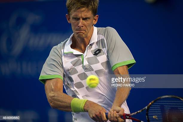 South Africa's tennis player Kevin Anderson returns the ball to Japan's tennis player Kei Nishikori during their Mexico ATP Open men's singles...