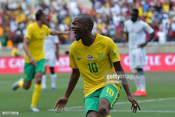 South Africa's Thulani Serero celebrates after scoring a goal during the 2018 World Cup qualifying football match between South Africa and Senegal on...