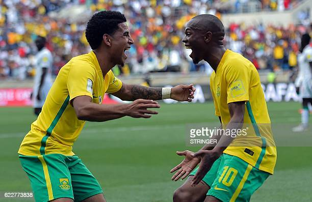 South Africa's Thulani Serero celebrates with South Africa's Keegan Dolly after scoring a goal during the 2018 World Cup qualifying football match...