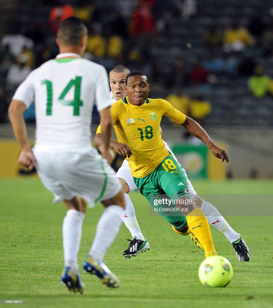 South Africa's Thuso Phala vies with Algerian players during a friendly football match between South Africa's Bafana Bafana and Algeria in Soweto on January 12 , 2013, ahead of the 2013 African Cup of Nations that will take place in South Africa from January 19 to February 10. AFP PHOTO / ALEXANDER JOE