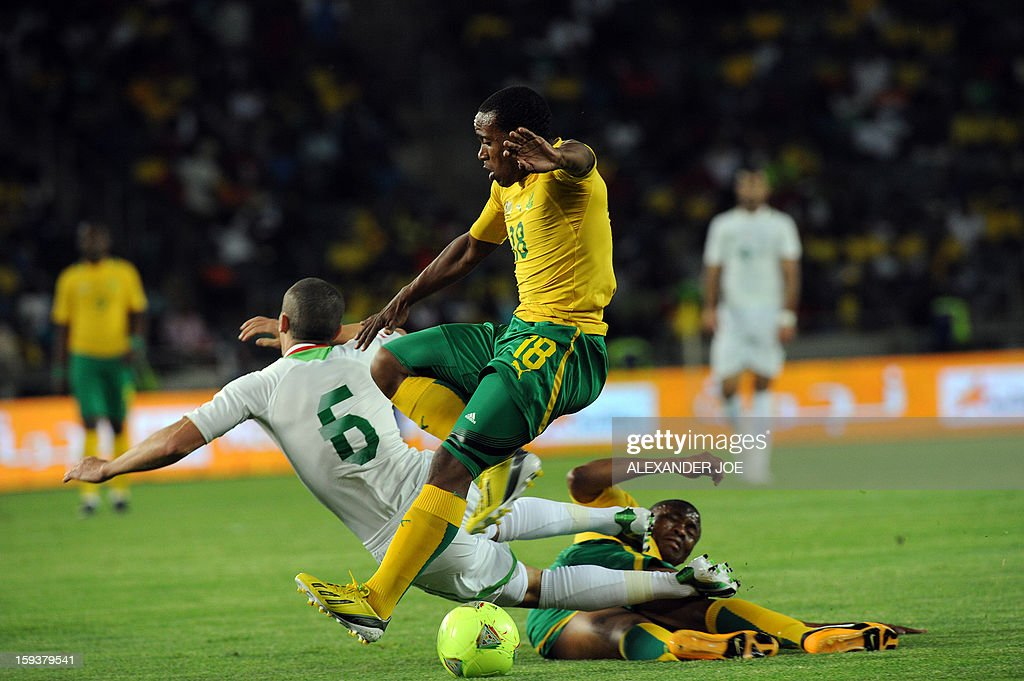 South Africa's Thuso Phala (C) vies with Algeria's Djamel Mesbah (L) during a friendly football match between South Africa's Bafana Bafana and Algeria in Soweto on January 12 , 2013, ahead of the 2013 African Cup of Nations that will take place in South Africa from January 19 to February 10.