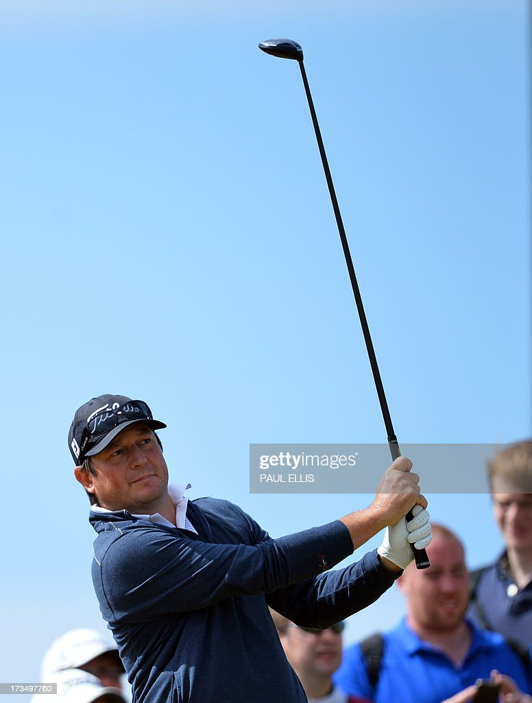 South Africa's Tim Clark plays a tee shot at Muirfield golf course at Gullane in Scotland on July 15, 2013 ahead of The 2013 Open Golf Championship.
