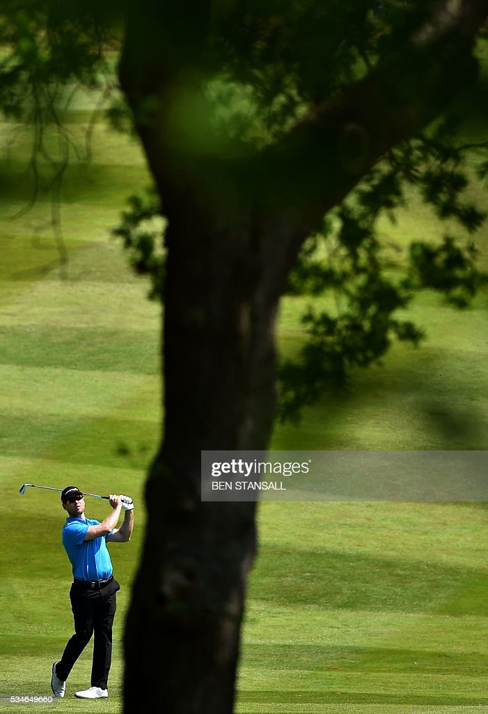 South Africa's Trevor Fisher Jnr plays his second shot from the fairway of the 7th hole on the second day of the PGA Championship at Wentworth Golf Club in Surrey, south west of London on May 27, 2016. / AFP / BEN