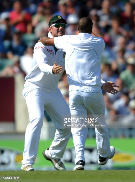 South Africa's Vernon Philander celebrates with his captain Greame Smith after taking the wicket of Alastair Cook during the Investec first test...