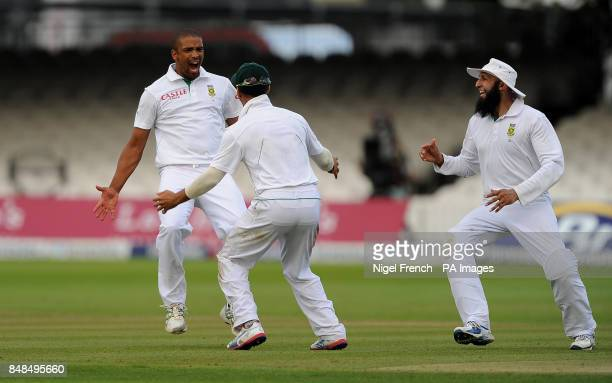 South Africa's Vernon Philander celebrates with team mates after taking England's last wicket during the Third Investec Test Match at Lord's Cricket...