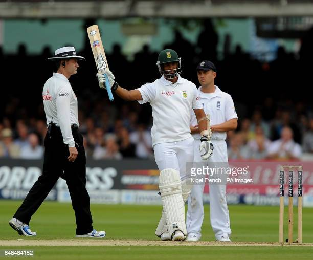 South Africa's Vernon Philander raises his bat after reaching a half century against England during the Third Investec Test Match at Lord's Cricket...