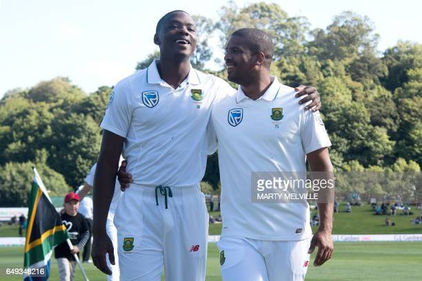 CORRECTION South Africa's Vernon Philander with team mate Kagiso Rabada walk from the field after the national anthems during day one of the 1st...