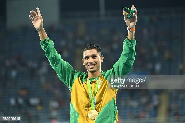 South Africa's Wayde van Niekerk celebrates during the podium ceremony for the men's 400m during the athletics event at the Rio 2016 Olympic Games at...