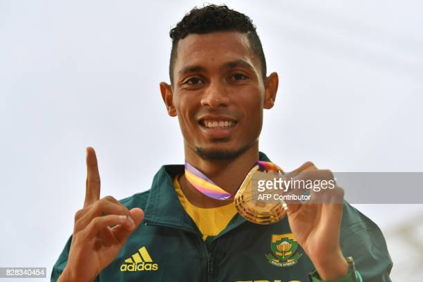 South Africa's Wayde Van Niekerk poses on the podium during the victory ceremony for the men's 400m athletics event at the 2017 IAAF World...