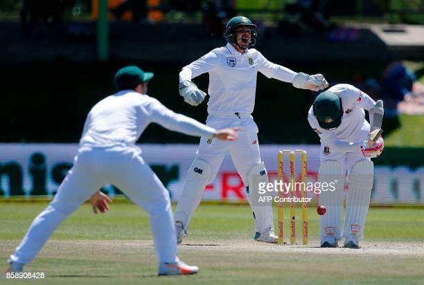 South Africa's wicketkeeper Quinton de Kock makes an unsuccesful appeal for a leg before wicket decision against Bangladesh batsman Mushfiqur Rahim...