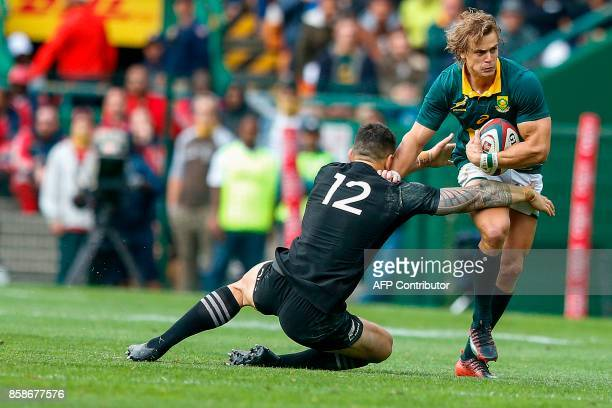 South Africa's winger Andries Coetzee is tackled by New Zealand's centre Sonny Bill Williams during the Rugby test match between South Africa and New...