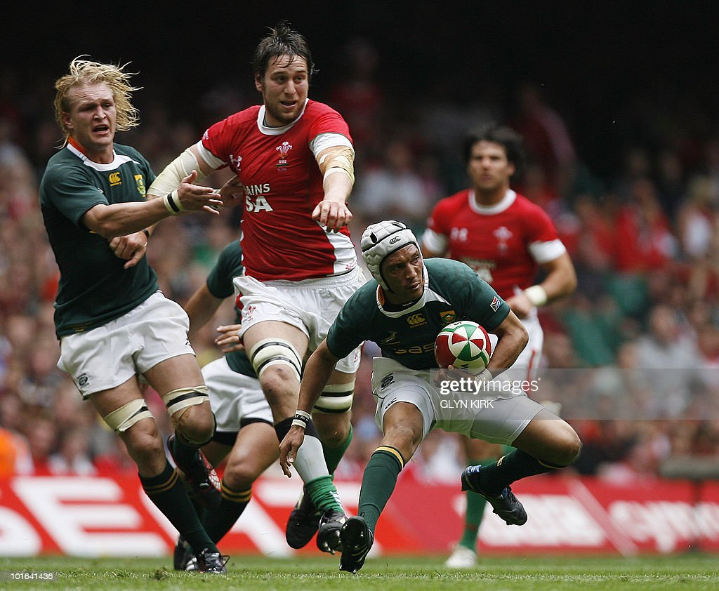 South Africa's winger Gio Aplon (R) evades a Welsh tackle during an international friendly rugby match at the Millennium Stadium in Cardiff, Wales on June 5, 2010.