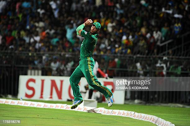 South Africa'sAB de Villiers takes a catch to dismiss Sri Lankan batsman Lahiru Thirimanne during the first Twenty20 cricket match between Sri Lanka...