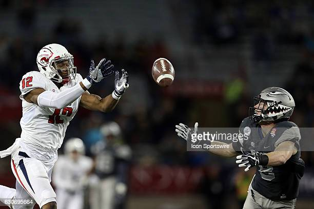 South Alabama Jaguars tight end Gerald Everett and Air Force Falcons defensive back Weston Steelhammer can't hang on to a pass during the second half...