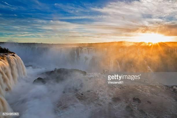 South America, Argentina, Brazil, Iguazu National Park, Iguazu Falls at sunset