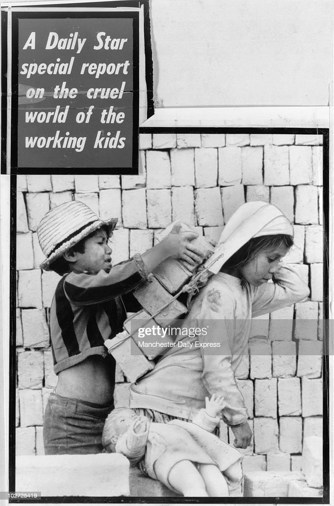 South American children at work, 1979. At this young age in Britain children play with bricks and dolls, but this little girl in South America can't afford to dally with her toys as she slaves away on a building site. She and her little helper must work all day to earn enough money just to feed themselves.