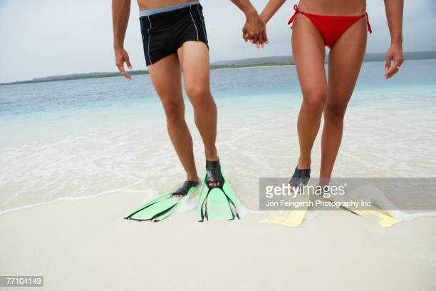 South American couple wearing flippers