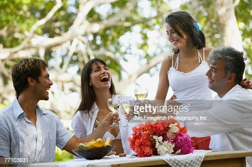 South American couples toasting with wine : Stockfoto