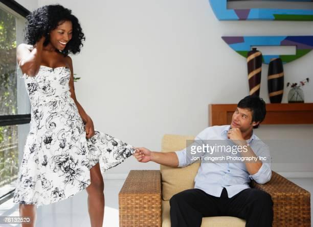 South American man grabbing girlfriend's skirt