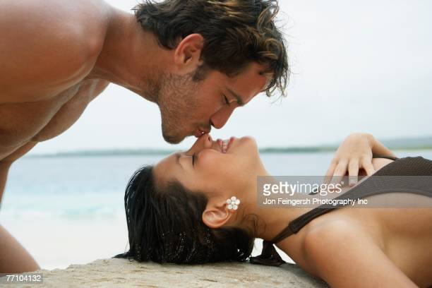 South American man kissing girlfriend on nose