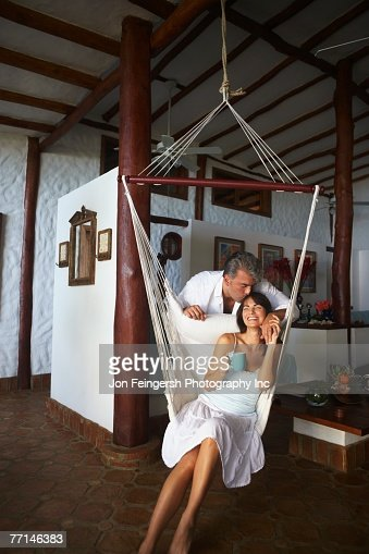 South American man kissing wife's head : Stock Photo