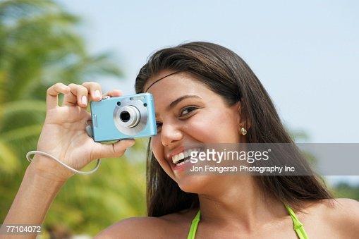 South American woman taking photograph : Foto de stock