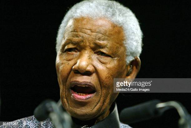 South Arica Former President Nelson Mandela Graca Machel and Kofi Annan at a conference in celebrating his birthday and launching The Elders project