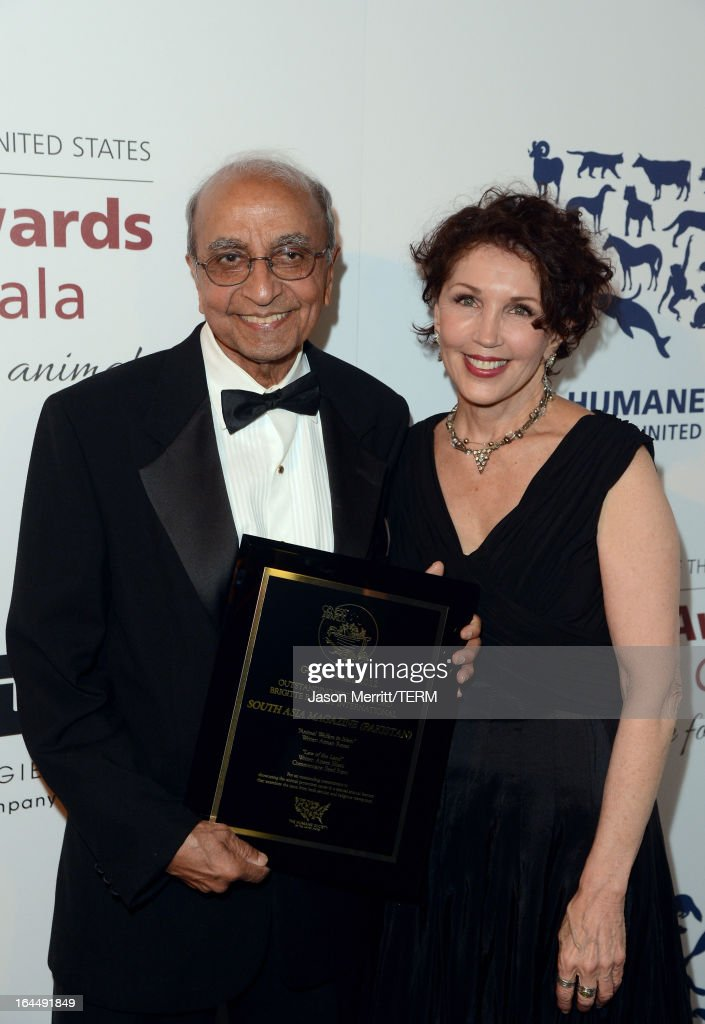 South Asia Magazine Special Correspondent Syed Rizvi poses with the Outstanding Written Word Brigitte Bardot International award and Senior Director of Hollywood Outreach HSUS Beverly Kaskey at The Humane Society of the United States 2013 Genesis Awards Benefit Gala at The Beverly Hilton Hotel on March 23, 2013 in Los Angeles, California.