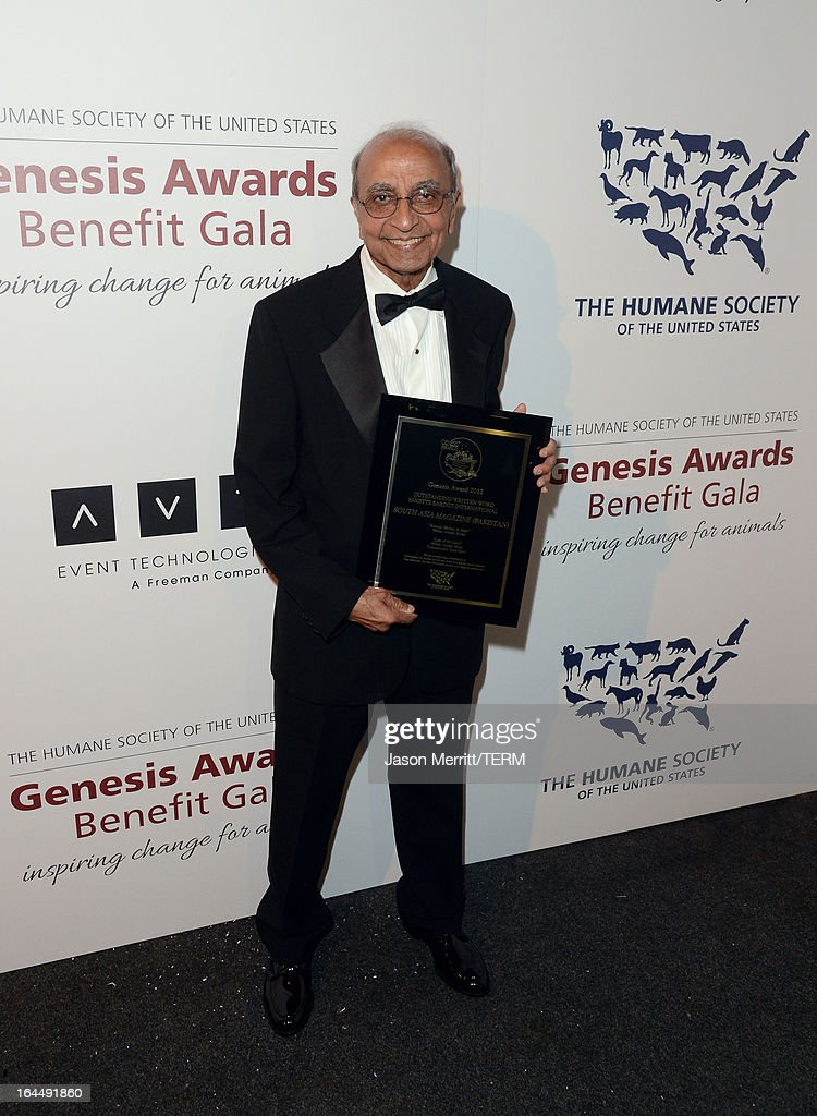 South Asia Magazine Special Correspondent Syed Rizvi poses with the Outstanding Written Word Brigitte Bardot International award at The Humane Society of the United States 2013 Genesis Awards Benefit Gala at The Beverly Hilton Hotel on March 23, 2013 in Los Angeles, California.