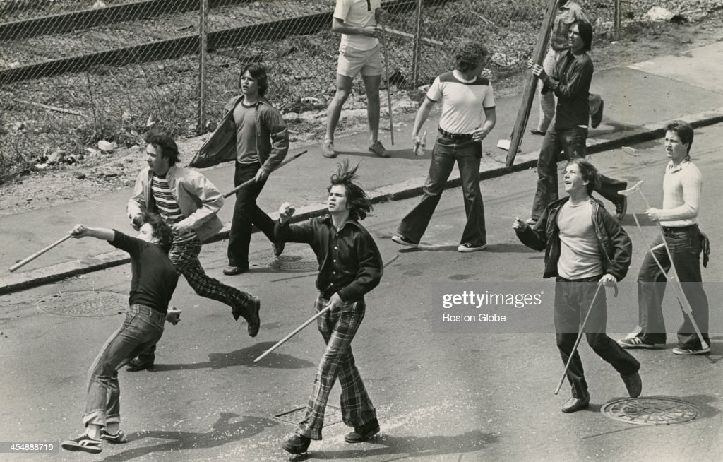 South Boston youths some throwing stones and others carrying sticks follow members of the Progressive Labor Party who had gathered for a national...