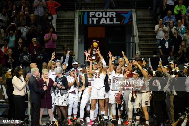 South Carolina celebrates on stage following their victory over Mississippi State during the 2017 Women's Final Four at American Airlines Center on...
