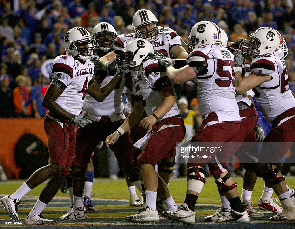 South Carolina celebrates quarterback Stephen Garcia's (5), center, fourth quarter rushing touchdown during the Gamecocks' 36-14 victory over the Florida Gators at Ben Hill Griffin Stadium in Gainesville, Florida, Saturday, November 13, 2010.