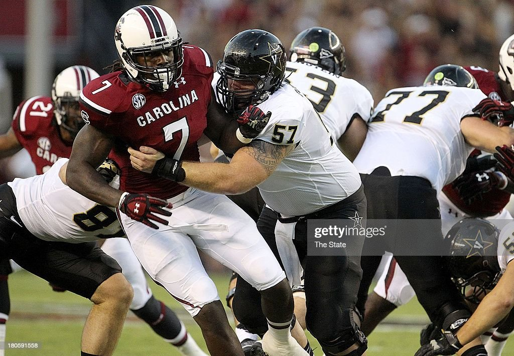 South Carolina defensive end Jadeveon Clowney (7) gets blocked by Vanderbilt offensive linesman Joe Townsend (57) during the first half at Williams Brice Stadium in Columbia, South Carolina, Saturday, September 14, 2013. South Carolina defeated Vanderbilt, 35-25.