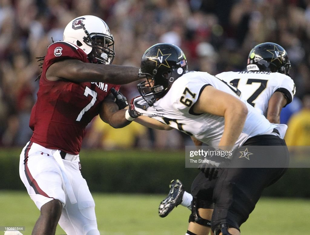 South Carolina defensive end Jadeveon Clowney (7) tries to push past Vanderbilt offensive linesman Wesley Johnson (67) during the first half at Williams Brice Stadium in Columbia, South Carolina, Saturday, September 14, 2013. South Carolina defeated Vanderbilt, 35-25.