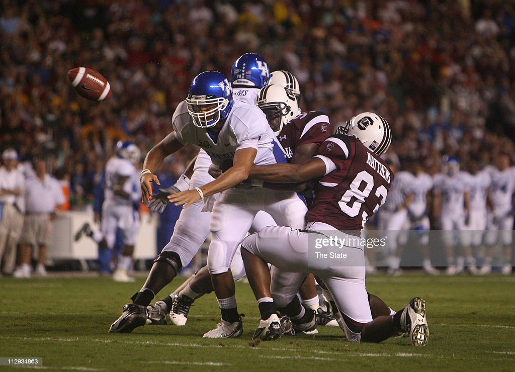 South Carolina defensive end Jonathan Williams (99) and defensive end Cliff Matthews (83) force a fumble from Kentucky quarterback Andre' Woodson (3) during the first quarter at Williams-Brice Stadium in Columbia, South Carolina, Thursday, October 4, 2007. The play resulted in South Carolina touchdown.