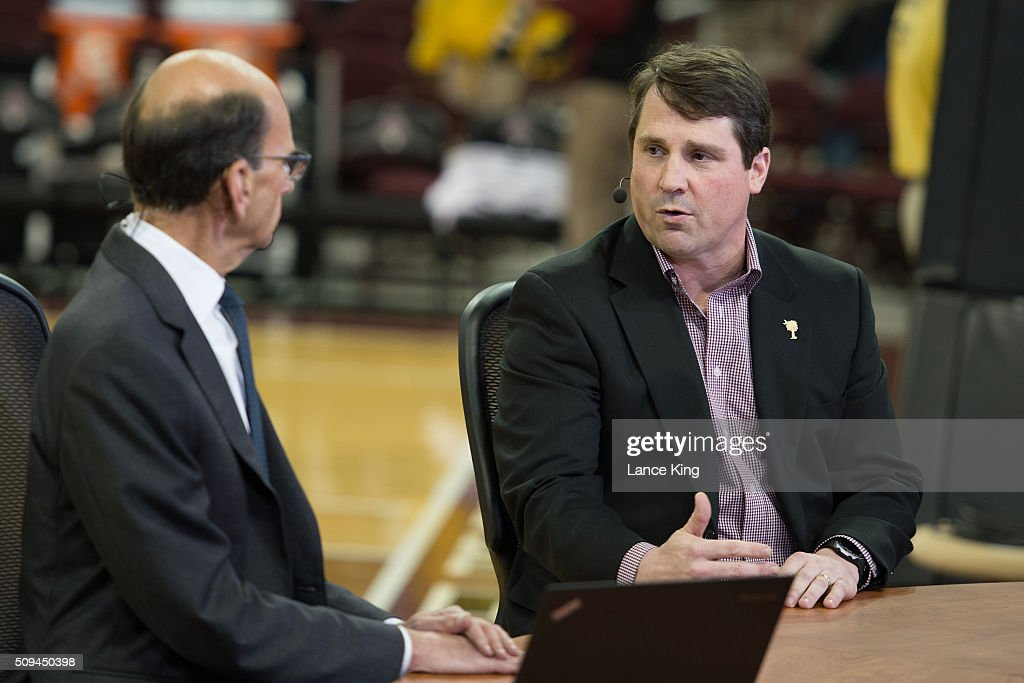 South Carolina football head coach Will Muschamp speaks with radio personality Paul Finebaum prior to the game between the Connecticut Huskies and...