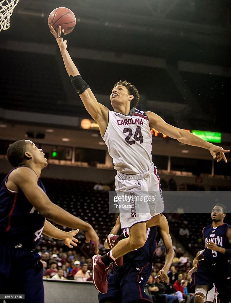 South Carolina forward Michael Carrera (24) shoots over USC Aiken guard DeVontae Wright (4) during an exhibition game at Colonial Life Arena in Columbia, South Carolina, Sunday, Novembe 3, 2013.