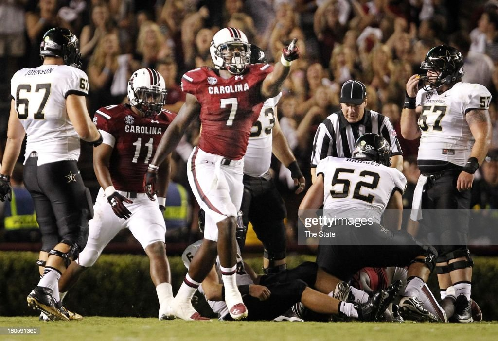 South Carolina Gamecocks defensive end Jadeveon Clowney (7) celebrates after sacking Vanderbilt Commodores quarterback Austyn Carta-Samuels (6), which caused a fumble, in the third quarter at Williams-Brice Stadium in Columbia, South Carolina, Saturday, September 14, 2013. South Carolina defeated Vanderbilt, 35-25.