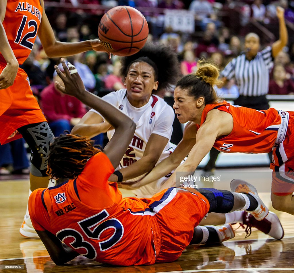 South Carolina Gamecocks guard Ieasia Walker (2) and Auburn Tigers forward Cabriana Capers (35) and Auburn Tigers guard Najat Ouardad (3) battle for a loose ball during the first half at Colonial Life Arena in Columbia, South Carolina, Sunday, February 3, 2013.
